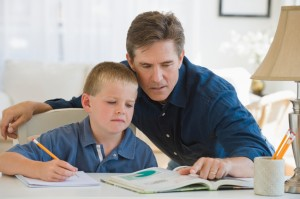 Homeschool With Success Father helping his son with homework