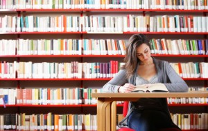 SAT/ACT Preparation - Part 1 Portrait of a student girl studying at library